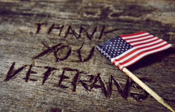 Text tackar dig veteran och flaggan av USA Fotografering för Bildbyråer