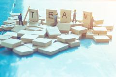 Text `TEAM` on wooden sheet paste on the table. Royalty Free Stock Images