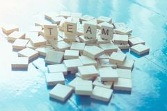 Text `TEAM` on wooden sheet paste on the table. Royalty Free Stock Photos