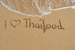 Text Thaifood. The text I love thaifood written in the sand at the beach stock photos