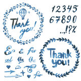 Text thank you on a blue watercolor spots. Stock Photo