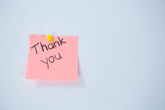 Text thank you written on adhesive note Royalty Free Stock Photo