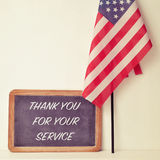 Text thank you for your service in a chalkboard and the flag of Royalty Free Stock Photo