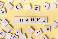 Text of THANKS on wooden cubes. Wood abc stock images