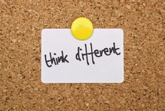 Text Think Different. Written on a pinned white sticker stock image