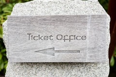 Text ticket office with arrow on wooden panel Royalty Free Stock Photography