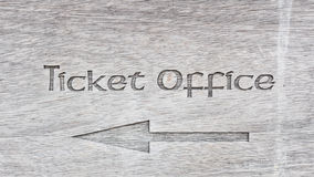 Text ticket office with arrow on wooden panel Stock Photos