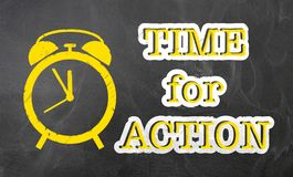 Text TIME FOR ACTION on blackboard with alarm clock icon. Text TIME FOR ACTION on chalkboard with alarm clock icon royalty free stock photo