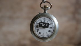 Text time and pocket watch stock video footage