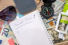 Text time to travel on notebook with selfie stick, money, glasses Stock Images