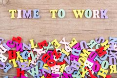 Text `Time to work` of colored wooden letters royalty free stock images