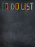 Text 'To Do List' created with oil pastels on slate. Background Stock Image