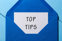 Text TOP TIPS on paper in blue envelope. Business concept Royalty Free Stock Image