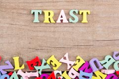 Text `Trast` of colored wooden letters royalty free stock photo