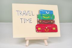 Text travel time, postcard with text and bunch of vintage colored suitcases Royalty Free Stock Photography
