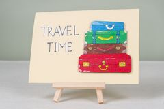 Text travel time, postcard with text and bunch of vintage colored suitcases Stock Photo