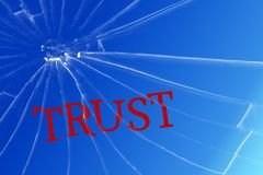 The text Trust on the broken glass. Deceived trust. Lie concept stock photo