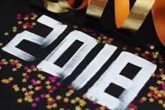 Text und Dekoration mit 2018 Zahlen Stockfotografie