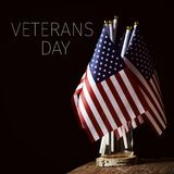 Text veterans day and american flags royalty free stock photos