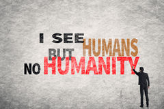 Text on wall, I See Humans But No Humanity Royalty Free Stock Photo