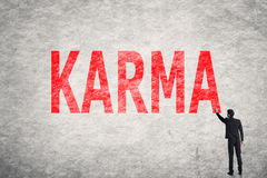 Text on wall, Karma. Asian businessman write text on wall, Karma Royalty Free Stock Photography