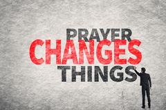 Text on wall, Prayer Changes Things. Asian businessman write text on wall, Prayer Changes Things Stock Image