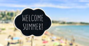 Text welcome summer on the beach Stock Photography
