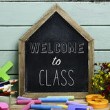 Text welcome to class in a house-shaped chalkboard Royalty Free Stock Photos