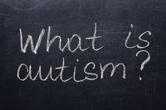 Text WHAT IS AUTISM?. Written on chalk board Royalty Free Stock Photography