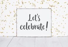 Text on white board lets celebrate with golden party confetti ag royalty free stock photos