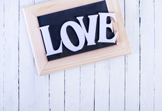 Text. White text love on the wooden table Royalty Free Stock Image