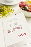 Text will you be my valentine in a postcard Royalty Free Stock Photo