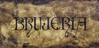Text witchcraft. Detail of an ancient text with the word witchcraft, witches celebration and party Stock Photography
