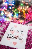 Text wooden blocks spelling the word be my valentine on pink background royalty free stock photo