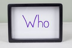 Text word WHO, black frame, on white table. Text word WHO, in black frame, on white table stock images