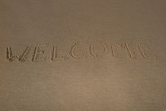 """Text  """"welcome"""" on the beach sand Royalty Free Stock Photo"""