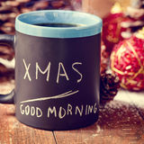 Text xmas good morning written in a mug with coffee or tea Stock Image