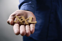 Text XXL in the hand of a man. Closeup of some wooden letters forming the expression XXL, for extra extra large, in the hand of a young caucasian man Stock Photo