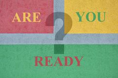 Text Are You Ready. And question mark on textured background Stock Images