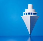 Text your cruises on left side. Symbol made of paper with blue background Stock Photography