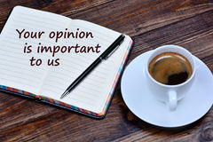 Text Your opinion is important to us on notebook. Page royalty free stock photo