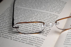 Textbook and glasses. An old history textbook and reading glasses Royalty Free Stock Image