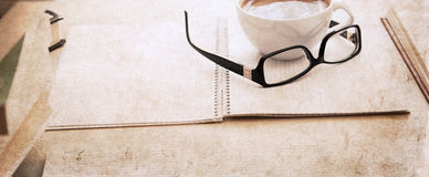 Textbook, glasses and cup of coffee Stock Photography