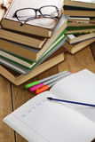 The textbook with pen. On it on the wooden desk Royalty Free Stock Images