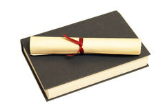 Textbook Success. A diploma sits on a textbook for education themes Royalty Free Stock Image