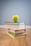Textbook with yellow apple Royalty Free Stock Image