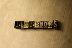 TEXTBOOKS - close-up of grungy vintage typeset word on metal backdrop Royalty Free Stock Photography