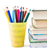 Textbooks and multicolor pencils. On white background royalty free stock photos