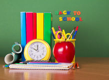 Textbooks, pencils, handles and apple Stock Image