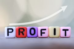 Textbox of Profit and green blur bokeh background. Royalty Free Stock Photography